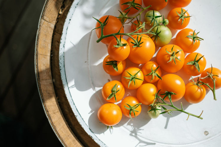 High angle view of tomatoes on plate on table