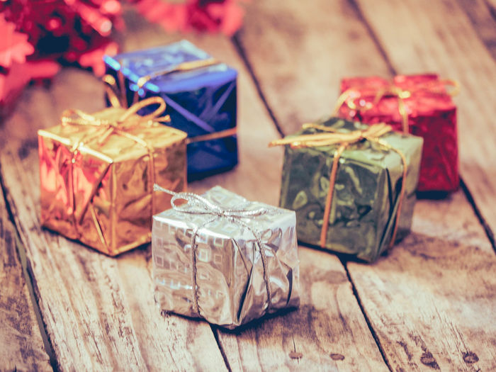 Close-up of colorful gift boxes on wooden table