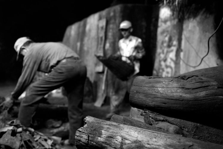 Making charcoal is a hard job Coolie Hard Old Photo Rural Tradition Black And White Photo Burn Wood Charcoal Day Heat Historical Kiln Labor Force Making Charcoal Men Nostalgia One Person Outdoors People Real People Wood - Material Wood Burning