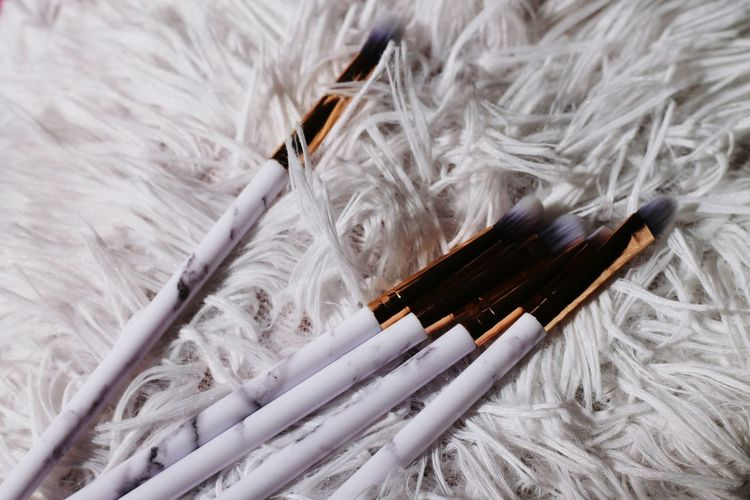 Close-up of make-up brushes on carpet