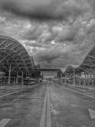 Cloudy afternoon Architecture Building Exterior Built Structure City Cloud - Sky Connection Day Diminishing Perspective Direction No People Outdoors Overcast Sky Transportation