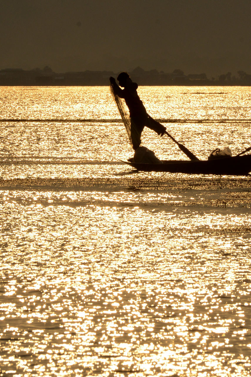 silhouette, water, sunset, real people, one person, sea, sunlight, nature, outdoors, leisure activity, shadow, full length, scenics, sport, nautical vessel, men, adventure, beauty in nature, day, extreme sports, jet boat, sky, people