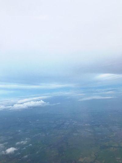 วิว Aerial View Nature Beauty In Nature Scenics Cloud - Sky Tranquility Tranquil Scene No People Outdoors Sky Day The Natural World Landscape Sky Only Backgrounds Sea Water View Into Land Airplane Wing View From An Airplane
