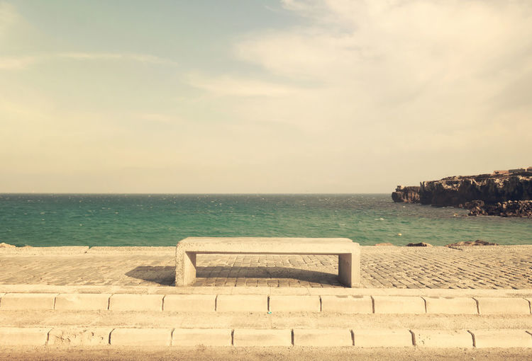 A break on the way Beach Bench Horizon Over Water Idyllic Outdoors Sea Tranquil Scene Tranquility Vacations