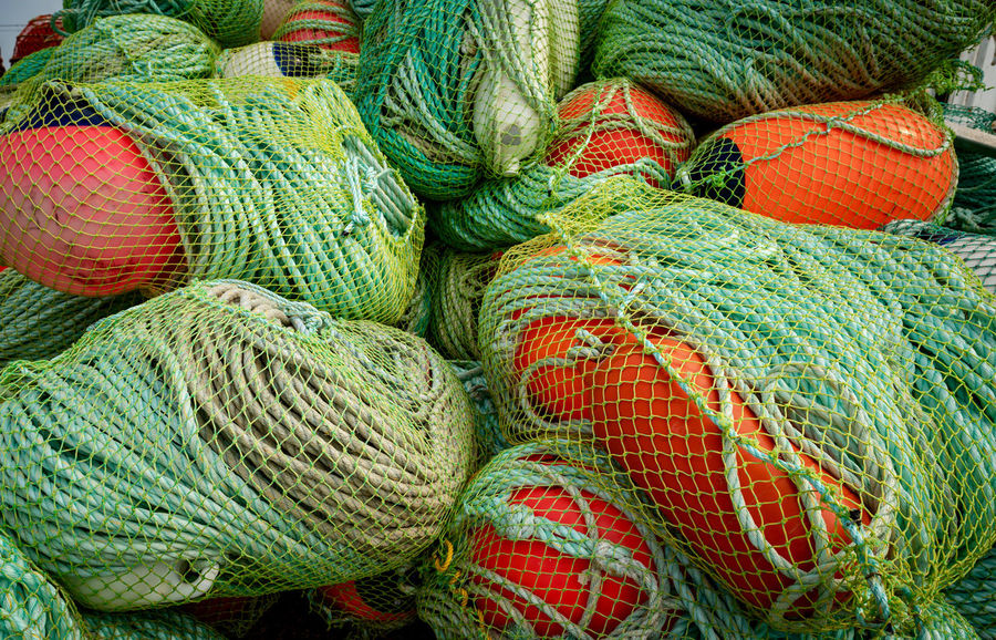 Partner Collection The EyeEm Collection Rope Abundance Backgrounds Choice Close-up Commercial Fishing Net Complexity Day Fishing Fishing Industry Fishing Net Full Frame Green Color High Angle View Large Group Of Objects Multi Colored No People Orange Color Outdoors Pattern Rope Stack Still Life Variation Wide Angle Fishing Net Fishing Rod Rope