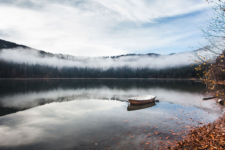 Water Lake Tranquility Reflection Scenics - Nature Tranquil Scene Nautical Vessel Beauty In Nature Sky Tree Cloud - Sky Nature No People Idyllic Non-urban Scene Fog Transportation Day Plant Floating On Water Rowboat Fog Over Water Fall Beauty Reflection Boat