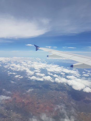 Aerial View Air Vehicle Airplane Airplane Wing Beauty In Nature Cloud - Sky Day Flying Journey Landscape Nature No People Outdoors Scenics Sky Tranquil Scene Tranquility Transportation Travel