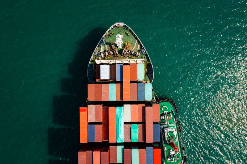 head shot from drone camera container cargo ship in import export business and industrial service