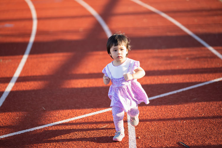 High angle view of girl running
