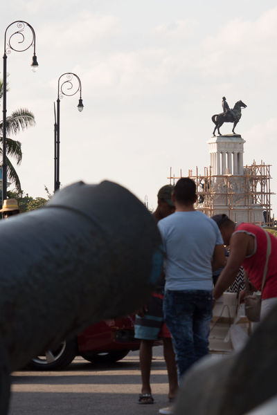 The whole picture Adult Adults Only Cannon Cuba Cuba Collection Day Daydreaming Habana Lamp Posts Leisure Activity Men Outdoors People Reconstruction Of The Monument Sky Statue Travelling Photography