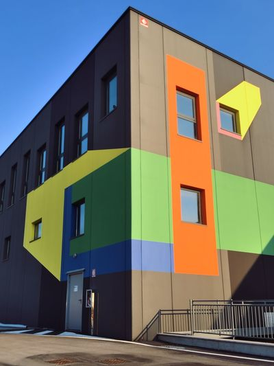 Exterior of colorful residential building against blue sky