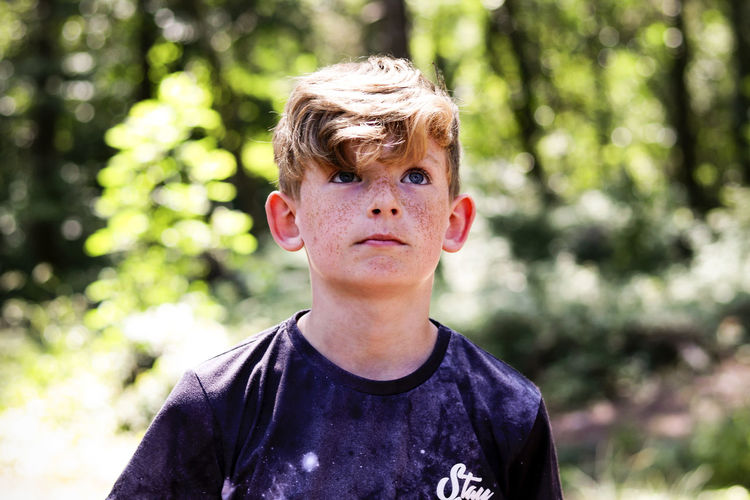 Portrait of a boy in the woods. Wood Young Boy Boys Casual Clothing Child Childhood Day Forest Front View Headshot Human Face Innocence Leisure Activity Lifestyles Looking At Camera Males  One Person Outdoors Portrait Portraiture Real People Teenager Tree Woods