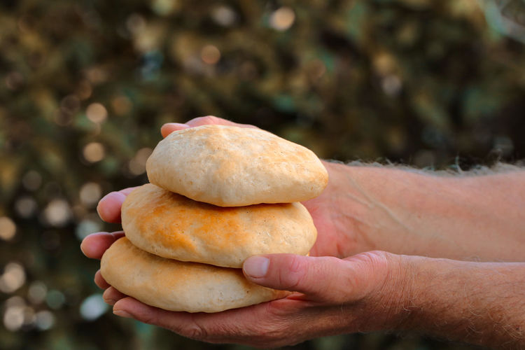 Close-up of hand holding bread