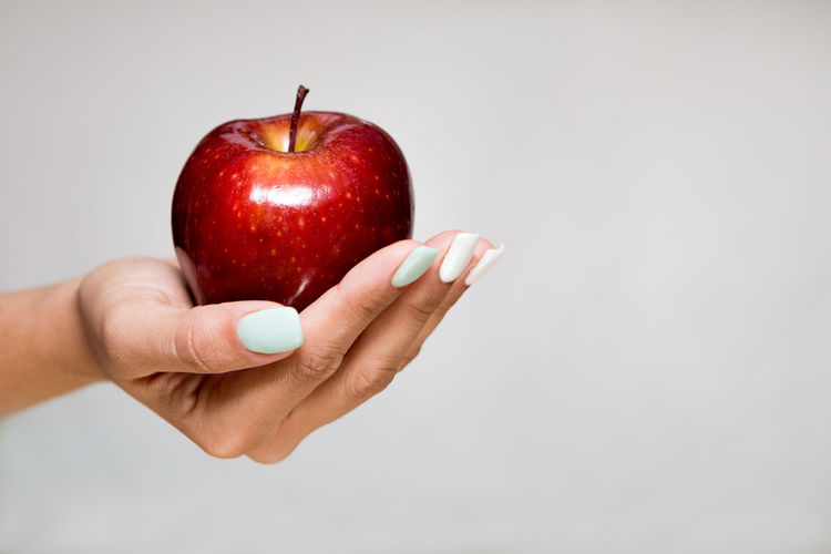 Temptation Woman Apple - Fruit Body Part Close-up Copy Space Enticing Finger Food Food And Drink Fruit Hand Healthy Eating Holding Human Hand Indoors  Offer One Person Red Single Object Studio Shot Tempting Wellbeing Woman Who Inspire You Women