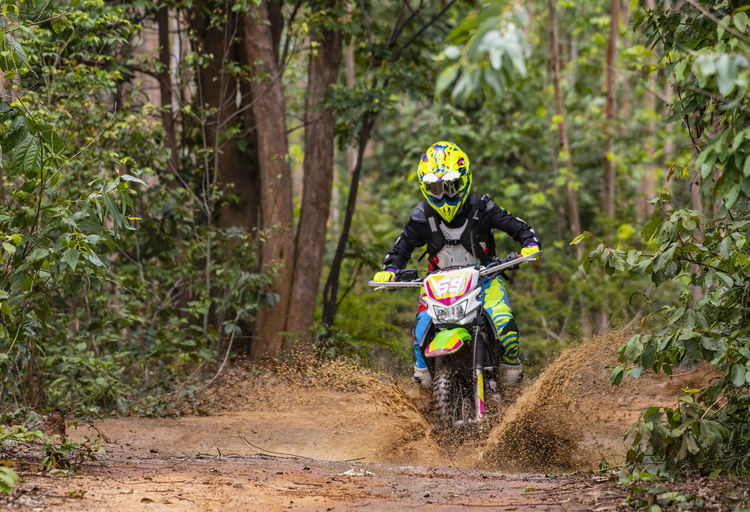 Man riding motorcycle in forest