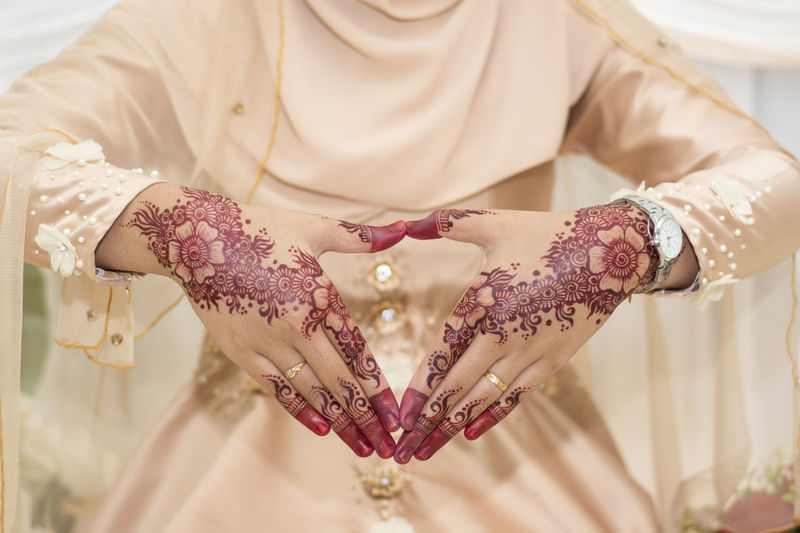 The design henna art of wedding photography EyeEm Selects EyeEmSelect Wedding Wedding Photography Adult Bracelet Bride Celebration Event Focus On Foreground Hand Henna Henna Art Henna Design Henna Tattoo Human Body Part Human Hand Indoors  Jewelry Midsection Newlywed Photography Tattoo Wedding Wedding Ceremony