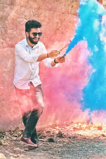 Holi Portrait Full Length Men Spraying Standing Looking At Camera Youth Culture Talcum Powder Powder Paint