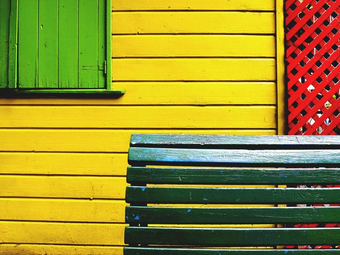 Puzzling Architecture Built Structure Yellow Wood - Material Pattern No People Holiday Moments Building Exterior Backgrounds Closed Door Window Multi Colored Day Metal Wall - Building Feature Shutter Entrance Full Frame Green Color Close-up