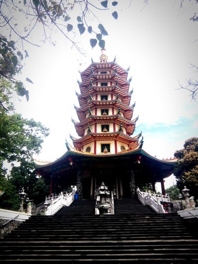 Buddhagaya Pagoda Religion Architecture Pagoda Built Structure Travel Destinations Sky Gold Tree Low Angle View Outdoors Cultures Day First Eyeem Photo