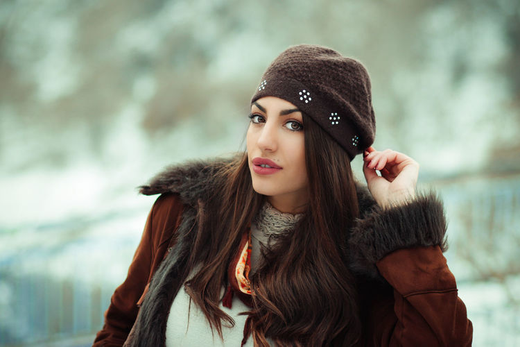 Tamara Adult Beautiful Woman Beauty Clothing Cold Temperature Fashion Focus On Foreground Front View Fur Hat Hair Hairstyle Hat Leisure Activity Lifestyles Looking At Camera One Person Outdoors Portrait Real People Scarf Warm Clothing Winter Young Adult Young Women
