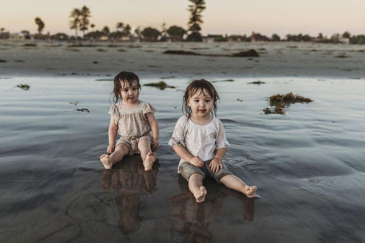 Full length portrait of children on shore