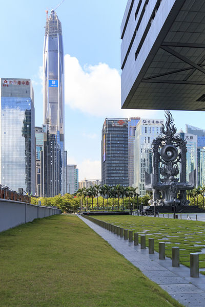 Shenzhen, China - August 19,2015: Shenzhen skyline as seen from the Stock Exchange building with the Ping An IFC, the tallest building of the city, on background Architecture ASIA Building Building Exterior Built Structure Bull China City Crisis Economy Financial Grass Guandong City Hong Kong Modern Office Building Ping An Ifc Shanghai Shenzhen Shenzhen.China Sky Skyscraper Stock Market Stockexchange Tall - High