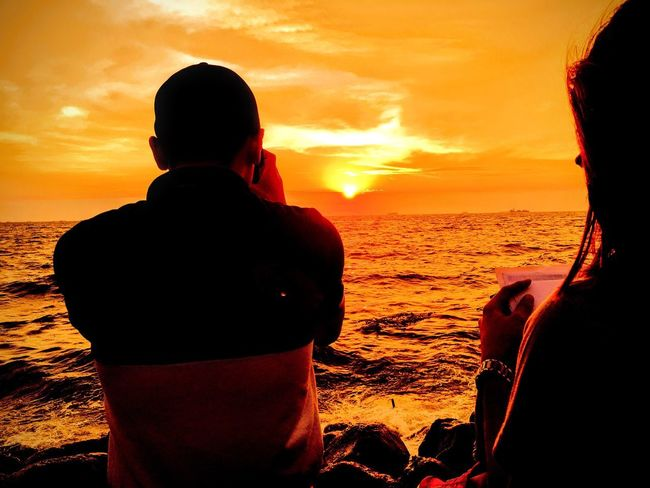Sunset Sea Two People Beauty In Nature Silhouette Togetherness Real People Leisure Activity Cloud - Sky