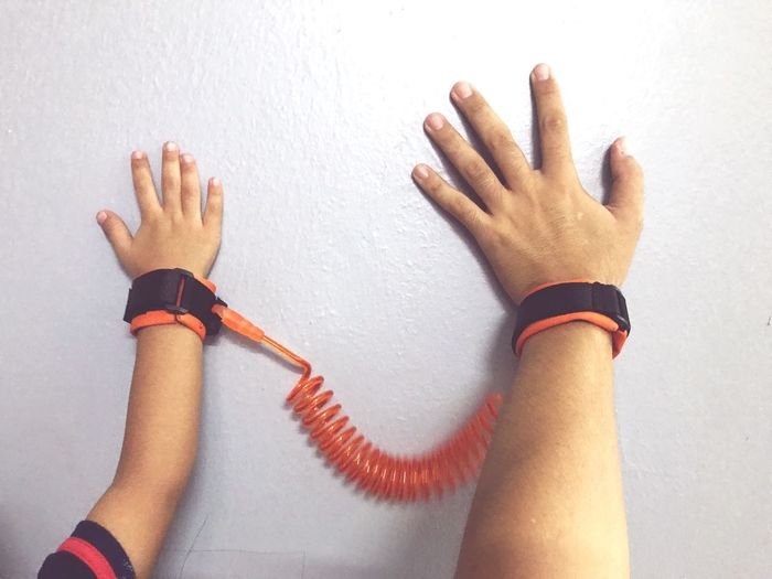 Kids safety harness Human Hand Hand Human Body Part One Person Real People Indoors  Body Part Human Finger Women Lifestyles Bracelet Adult Personal Perspective Close-up Wall - Building Feature Finger Human Limb Leisure Activity Touching Human Arm