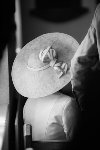 Blackandwhite Chapel Close-up Day Formal Portrait Guest Hat Indoors  No Face One Person People Pew Real People Wedding Wedding Ceremony Wedding Day Wedding Photography