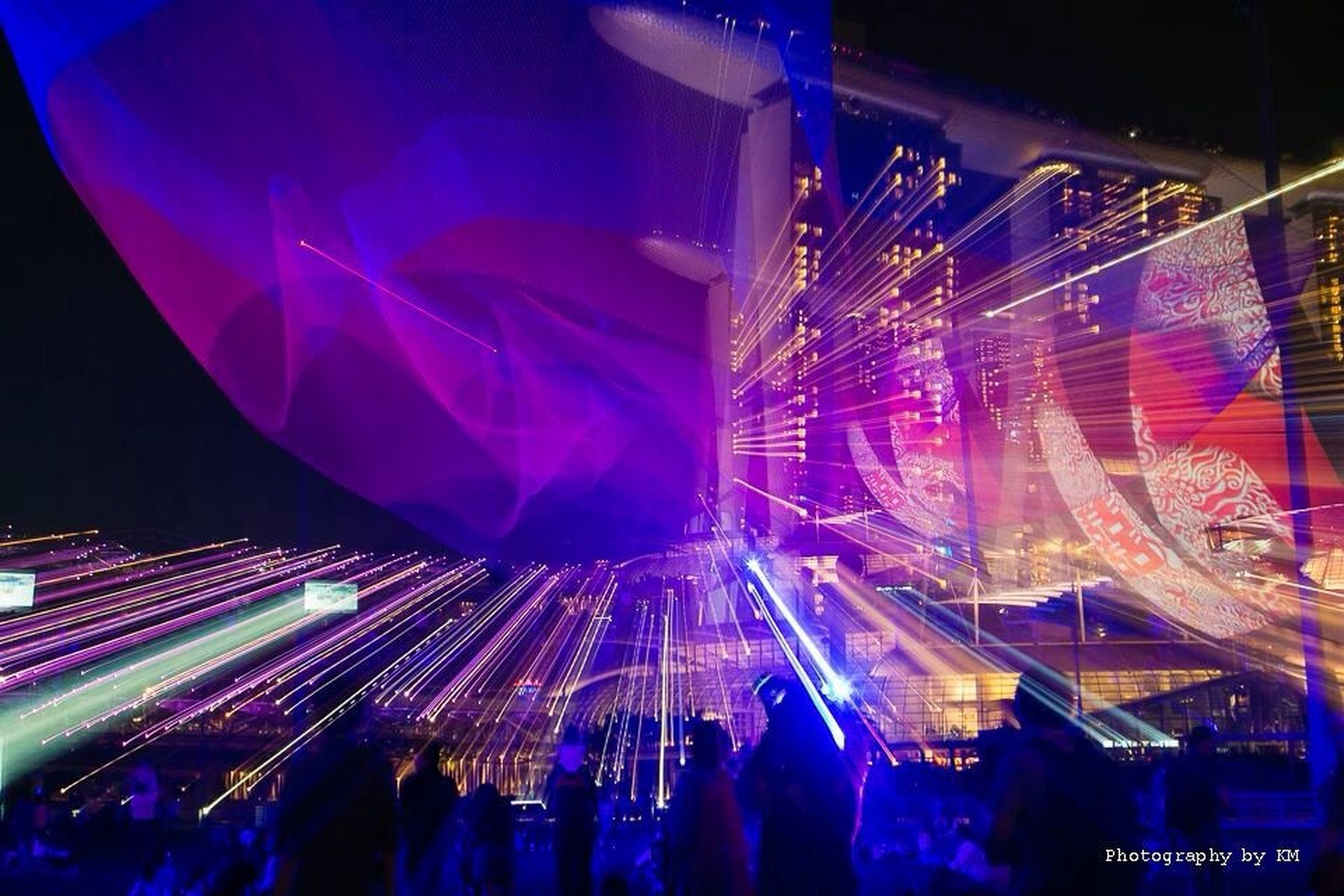 illuminated, large group of people, night, arts culture and entertainment, lifestyles, leisure activity, enjoyment, event, men, crowd, nightlife, fun, person, celebration, music, excitement, youth culture, stage - performance space, motion