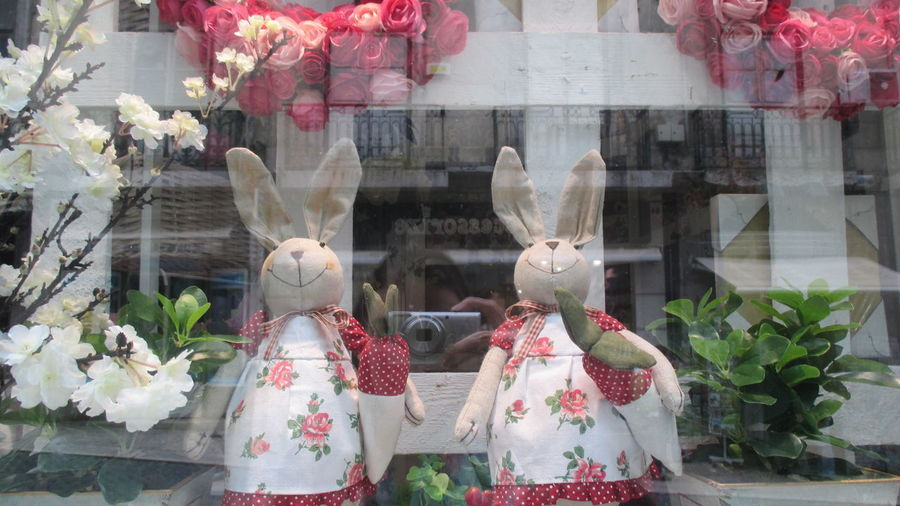 Art And Craft Bunny  Celebration Close-up Cultures Day Easter Easter Decoration Easter Decorations Easter Time  Female Likeness Figurine  Flower For Sale Indoors  No People Rabbits Retail  Retail Display Sculpture Statue Store Store Window Toy Bunnies Tradition