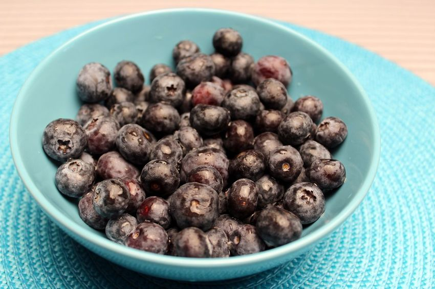 Blueberries background Berries Blackberries . Blue Background Bowl Ceramic Bowl Close-up Day Food Food And Drink Freshness Freshness Healthy Eating Indoors  Large Group Of Objects No People Ready-to-eat Top Perspective