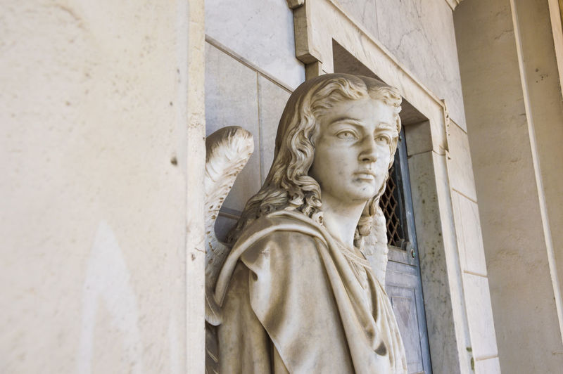 Angle Statue By Wall Of Church