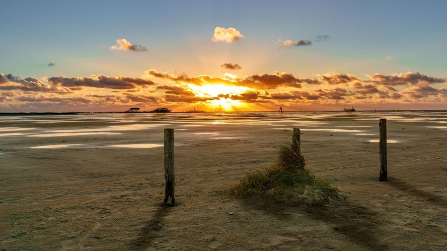 Sunset Sand Beach Beauty In Nature Nature Water Outdoors Sun Sea Scenics Landscape Cloud - Sky Sky No People Horizon Over Water Day