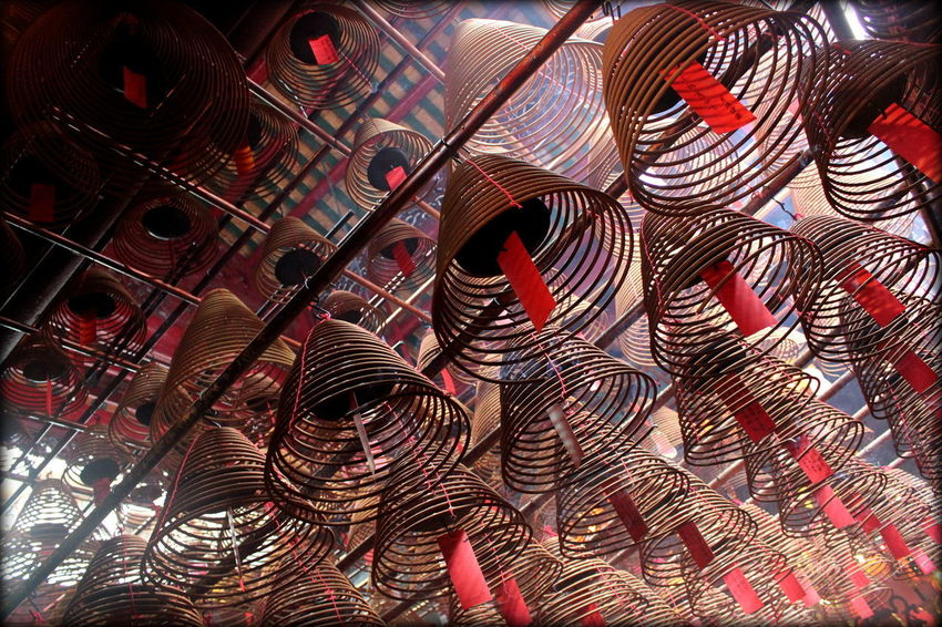 Incense coils at Man Mo temple, Hong Kong, China Calm Hanging Hong Kong Man Mo Temple Peace Pray Quiet Red Reflection Smoke Travel Backgrounds Chinese Coil Creativity Hanging Historic Incense Inside No People Religious  Serentiy Smell Spiral Tourism