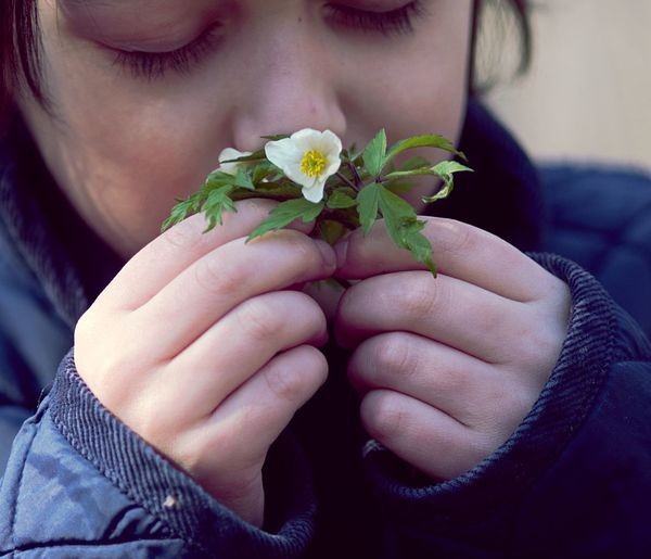 Windflower Smelling The Flowers Kid Eyes Closed  Calmness Tranquility Spring Spring Flowers Human Hand Beauty Herb Portrait Human Face Holding Blooming Flower Head Petal Pollen Single Flower