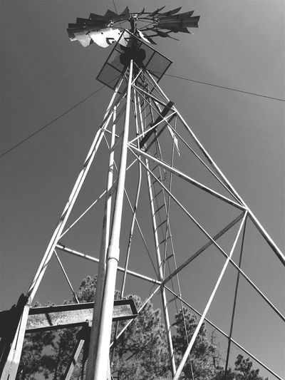 """""""Windmill Up"""" Skyward shot of an historic Aermotor of Chicago windmill in the Cibola National Forest of Central New Mexico, USA. Aermotor Windmill RuralExploration Rural Scenes Rural Country Road Newmexicophotography Newmexico Nationalforest Blackandwhite Photography Blackandwhite Black And White Windmill Pump"""