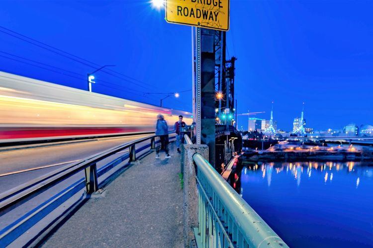 Architecture Blue Blurred Motion Clear Sky Communication Connection Illuminated Long Exposure Mode Of Transportation Motion Nature Outdoors Public Transportation Rail Transportation Sky Speed Train - Vehicle Transportation Travel Water