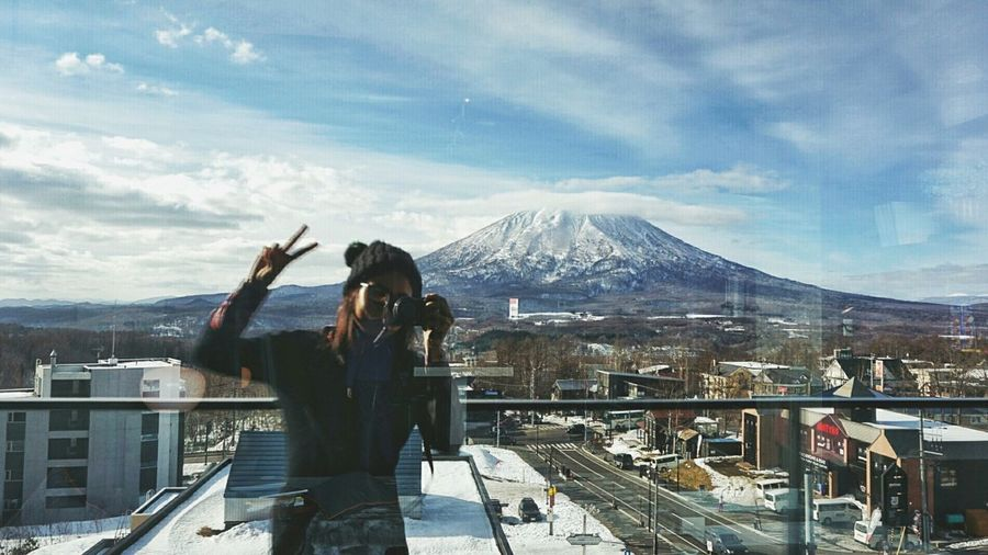 Woman taking self photograph with mt fuji in mirror reflection