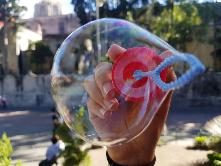 Red Blue Nails Plaza Hands Bubble Wand Childhood Water Close-up Bubble Blowing Forming Shape Refraction Building The Great Outdoors - 2018 EyeEm Awards