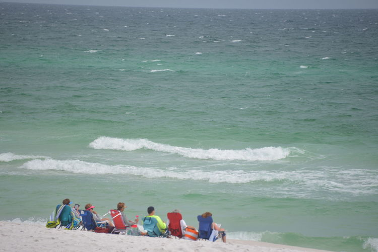 Beach Time. Beach Large Group Of People People Real People Teamwork Sand Wave Water Group Of People Adult Outdoors Sea Headwear Day Adults Only Sky