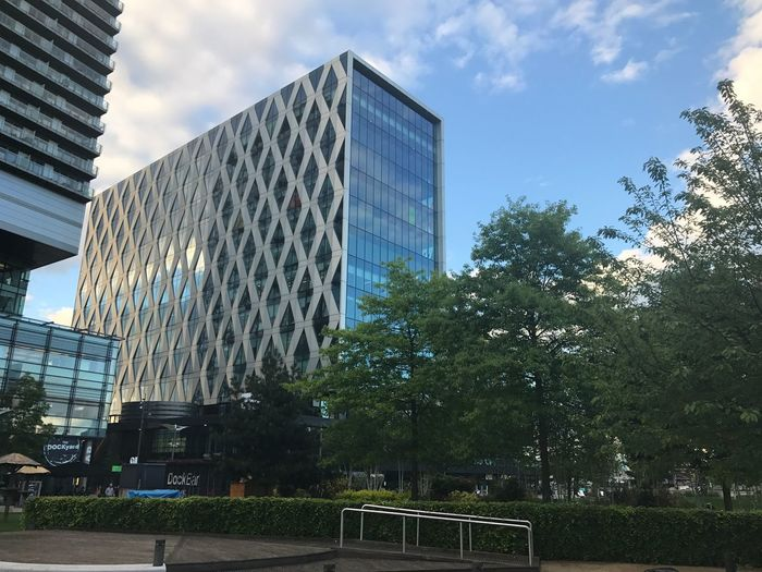 Architecture Building Exterior Skyscraper Modern Day Sky Tree Built Structure Outdoors Low Angle View City Growth No People