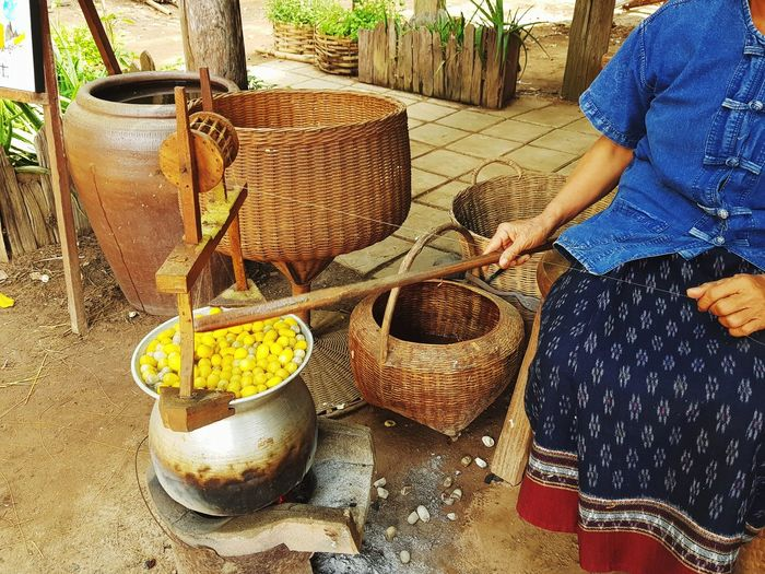 Original silk making Silkworm Silk Cocoons Traditional Costume Yarn Northeast Thailand Boiling Weaving Basket Real People Outdoors Women