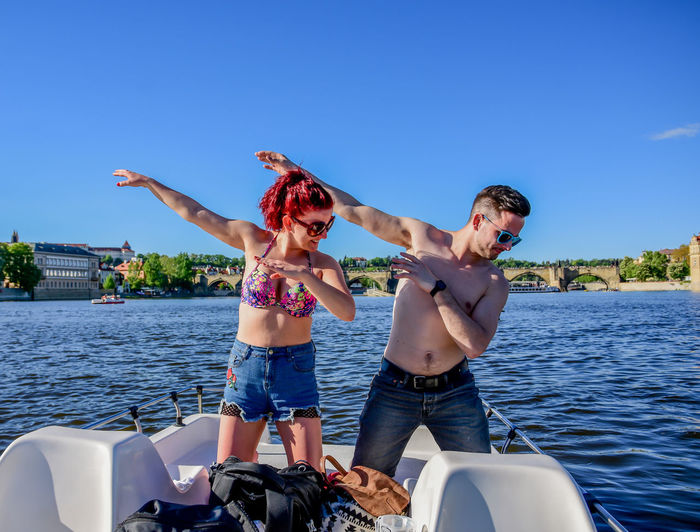 Adult Bonding Day Emotion Friendship Human Arm Leisure Activity Lifestyles Men Nature Outdoors Real People Sky Sunlight Three Quarter Length Togetherness Transportation Two People Water Women Young Women