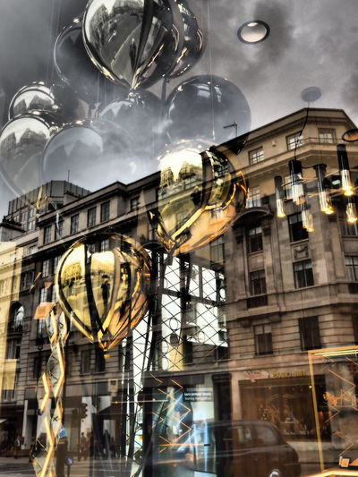 Flying Gold Gold Balloons Architecture Building Exterior Built Structure City Close-up Day Hanging Low Angle View No People Outdoors Refelctions Reflection Sky