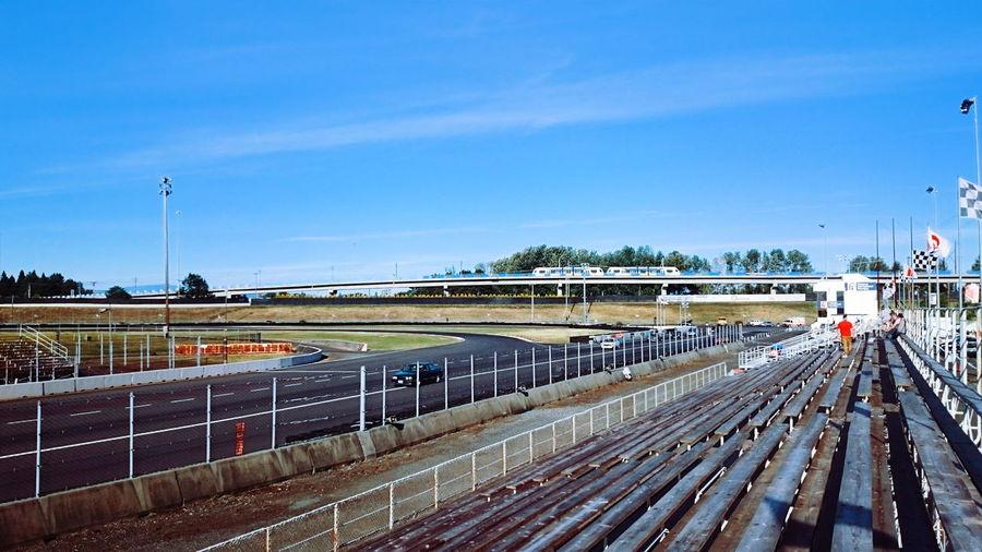 Motor racing track at stadium against sky