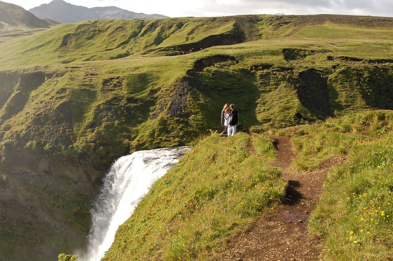 Adventure Beauty In Nature Casual Clothing Day Full Length Grass Green Color Hiking Iceland Landscape Leisure Activity Lifestyles Men Motion Mountain Nature Outdoors Real People Scenics Small Group Of People Standing The Great Outdoors - 2017 EyeEm Awards Tranquil Scene Walking Waterfall Place Of Heart Sommergefühle Breathing Space Lost In The Landscape