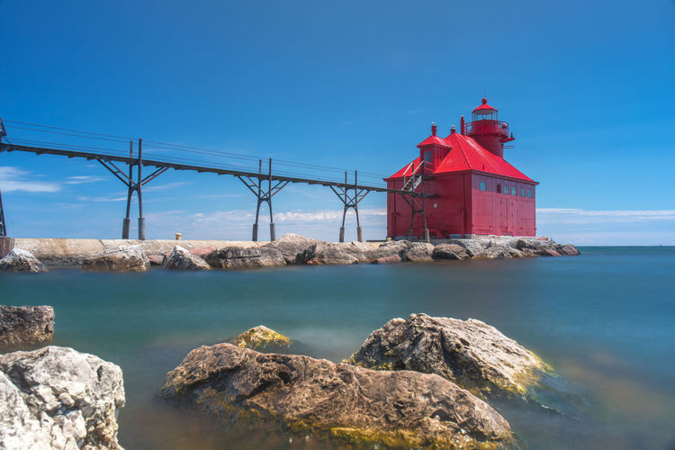 EyeEmNewHere EyeEmNewHerе Lake Michigan Lighthouse Sturgeon Bay Wisconsin Architecture Blue Built Structure Day Fishing Fishing Boat Lake Lighthouse Lighthouse_lovers Long Exposure Red Rock Rock - Object Scenics - Nature Sky Solid Summer Water