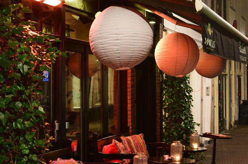 DenHaag Bar Street Lanterns Street Dining Red White Round The Hague Showcase March Cities At Night Hidden Gems