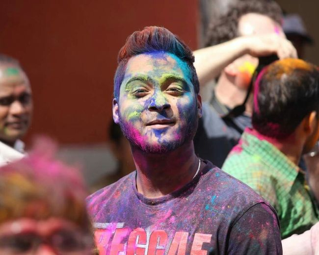Portrait of man covered in powder paint during holi